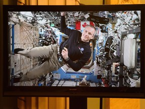Canadian Space Agency astronaut David Saint-Jacques is seen on a live monitor from the International Space Station during a video conference with Prime Minister Justin Trudeau and Governor General Julie Payette and a group of students at Rideau Hall in Ottawa on Monday, Jan. 14, 2019.