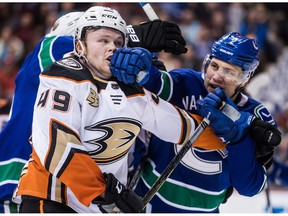 Anaheim Ducks' Max Jones, left, and Vancouver Canucks' Luke Schenn get into a scuffle during the third period of an NHL hockey game in Vancouver on February 25, 2019. Defenceman Luke Schenn has logged a lot of kilometres in the past few years. The former fifth-overall pick at the 2008 NHL draft has with the Arizona Coyotes, Anaheim Ducks and Vancouver Canucks over the past three seasons, and spent time with all of the teams' American Hockey League affiliates. The Ducks dealt Schenn to the Canucks in February and the 29-year-old made the most of his latest opportunity, carving out a much-needed niche as a physical blueliner who could compliment and protect the Canucks young talent.