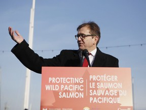 Federal Minister of Fisheries Jonathan Wilkinson speaks during an announcement with Premier John Horgan about the Salmon Restoration and Innovation Fund during a press conference at Fisherman's Wharf in Victoria, B.C., on Friday, March 15, 2019. Wilkinson today is announcing a total ban on all oil and gas activities, as well as mining, dumping of waste and bottom trawling, from all of Canada's marine protected areas.