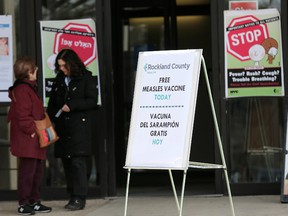 Signs about measles and the measles vaccine are displayed at the Rockland County Health Department in Pomona, N.Y., Wednesday, March 27, 2019.The county in New York City's northern suburbs declared a local state of emergency Tuesday over a measles outbreak that has infected more than 150 people since last fall, hoping a ban against unvaccinated children in public places wakes their parents to the seriousness of the problem.