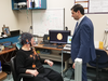 Parkinson's patient Gail Jardine with Dr. Mandar Job in his lab at Western University.