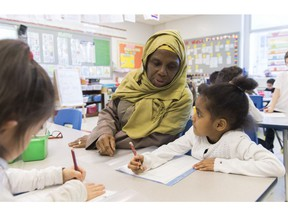 Kindergarten teacher Haniyfa Scott gives a lesson during class in Montreal, Thursday, April 4, 2019. The Quebec government's recently tabled Bill 21 bans the wearing of religious symbols for new government placed employees within schools, the courts and law enforcement.