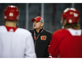 Calgary Flames' head coach Bill Peters talks to players during practice in Calgary, Tuesday, April 9, 2019.THE CANADIAN PRESS/Jeff McIntosh