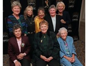 FILE - In this Oct. 19, 1999, file photo, eight founders of the Ladies Professional Golf Association (LPGA) pose at a celebration of the association's 50th anniversary in New York. Back row from left are Marilynn Smith, Marlene Hagge, Alice Bauer, Louise Suggs and Betty Jameson. Front row from left are Bettye Sanoff, Shirley Spork and Patty Berg. Marilynn Smith died Tuesday, April 9, 2019. She was 89.