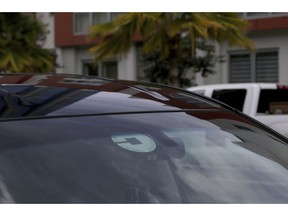 FILE- In this June 6, 2018, file photo Uber driver Joshua Oh drives in Honolulu. Uber launched a voucher program Tuesday, April 9, 2019, enabling companies like Westfield Mall and TGI Fridays to offer free or discounted Uber rides to customers.