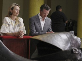 California Gov. Gavin Newsom with his wife, Jennifer Siebel Newsom visit the tomb of Archbishop Oscar Romero at Metropolitan Cathedral in San Salvador, El Salvador, Sunday, April 7, 2019. Newsom visited the tomb of Archbishop Romero, the Salvadoran priest assassinated in 1980 due to his advocacy for human rights and the poor.