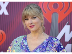 FILE - In this March 14, 2019, file photo, Taylor Swift arrives at the iHeartRadio Music Awards at the Microsoft Theater in Los Angeles. Swift says the efforts of a Tennessee LGBTQ advocacy group to fight against a handful of contentious bills moving inside the state's GOP-controlled General Assembly inspired her to make a sizeable donation.