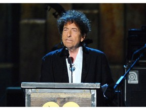 """FILE - In this Feb. 6, 2015 file photo, Bob Dylan accepts the 2015 MusiCares Person of the Year award at the 2015 MusiCares Person of the Year show in Los Angeles.  Dylan is set to help open a whiskey distillery in fall 2020 under the brand """"Heaven's Door."""""""
