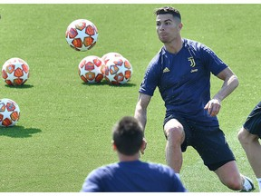 Juventus forward Cristiano Ronaldo eyes the ball during a training session on the eve of the first quarterfinal match against Ajax, in Turin, Italy, April 9, 2019.
