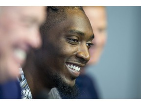 Dallas Cowboys defensive end Demarcus Lawrence, center, laughs during a press conference at The Star in Frisco, Texas, Tuesday, April 9, 2019. DeMarcus Lawrence may not be the highest-paid Dallas Cowboys player in history for long. It doesn't mean the club's best defensive end can't enjoy the distinction while it lasts. The 26-year-old Lawrence signed a $105 million, five-year contract Tuesday.