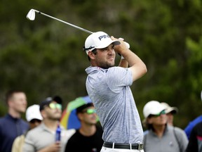 Corey Conners watches his drive on the third hole during the final round of the Texas Open golf tournament, Sunday, April 7, 2019, in San Antonio.