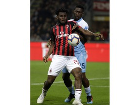 AC Milan's Franck Kessie, left, and Lazio's Quissanga Bastos challenge for the ball during the Italian Cup, second leg semifinal soccer match between AC Milan and Lazio, at the San Siro stadium, in Milan, Italy, Wednesday, April 24, 2019.