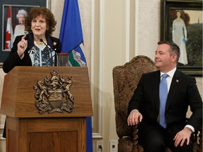 UCP Leader Jason Kenney (right) is seen with Lt.-Gov. Lois Mitchell before being sworn in as Alberta's 18th Premier at Government House during a ceremony in Edmonton, on Tuesday, April 30, 2019.