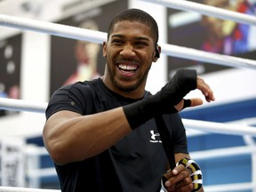 British boxer Anthony Joshua laughs, prior to a media session at the English institute of Sport, in Sheffield, England, Wednesday May 1, 2019. Andy Ruiz Jr. will look to become Mexico's first heavyweight champion after replacing Jarrell Miller as the opponent for unbeaten WBA, IBF and WBO titleholder Anthony Joshua.