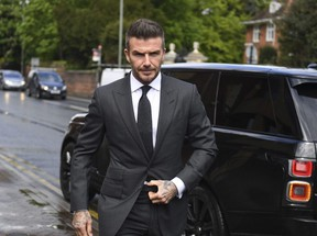 Soccer star David Beckham arrives at Bromley Magistrates Court for a hearing after he was spotted using his mobile phone while driving his Bentley, in London, Thursday, May 9, 2019.