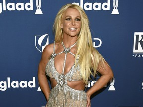 FILE - In this April 12, 2018 file photo, Britney Spears arrives at the 29th annual GLAAD Media Awards in Beverly Hills, Calif. Spears has been granted a restraining order against a former confidante who she says has been harassing her family. A judge Wednesday, May 8, 2019, ordered the man, 44-year-old Sam Lutfi, to stay at least 200 yards from Spears, her parents and her sons.