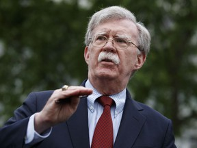 FILE - In this Wednesday, May 1, 2019 file photo, National Security Adviser John Bolton talks to reporters about Venezuela, outside the White House, in Washington. Bolton is scheduled to deliver the keynote address Wednesday, May 22, 2019, at the United States Coast Guard Academy graduation ceremony. Bolton has been President Donald Trump's national security adviser since April of last year.