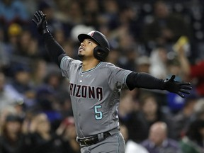Arizona Diamondbacks' Eduardo Escobar looks up after hitting a home run during the fourth inning of a baseball game against the San Diego Padres, Tuesday, May 21, 2019, in San Diego.