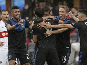 San Jose Earthquakes forward Chris Wondolowski, center back, is congratulated by teammates after scoring a goal against the Chicago Fire during the first half of an MLS soccer match in San Jose, Calif., Saturday, May 18, 2019.