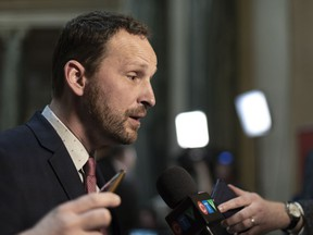 Opposition Leader Ryan Meili speaks to media during budget bay at the Legislative Building in Regina on Wednesday March 20, 2019. Saskatchewan's Opposition NDP leader is apologizing for the Sixties Scoop.THE CANADIAN PRESS/Michael Bell