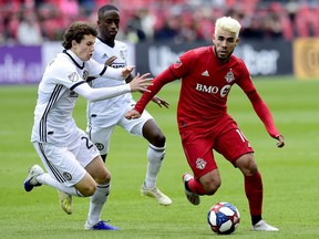 Philadelphia Union midfielder Brenden Aaronson (22) and teammate Jamiro Monteiro (35) pressure Toronto FC midfielder Alejandro Pozuelo (10) during second half MLS soccer action in Toronto on Saturday, May 11, 2019. While Toronto will be without the suspended Pozuelo for Sunday's visit by the San Jose Earthquakes, coach Greg Vanney says a week off for the Spanish playmaker may not be such a bad thing given his prolonged season since coming over from Europe.