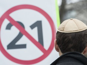 A man wears a yarmulke during a demonstration opposing the Quebec government's newly tabled Bill 21 in Montreal, Sunday, April 14, 2019. A majority of Quebecers and a third of Canadians believe elected officials at all levels should be banned from wearing religious symbols, according to a new poll.