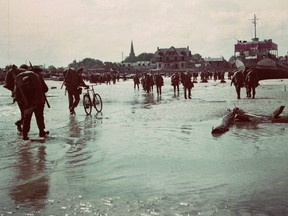 Canadian soldiers land on a Normandy, France beach during the D-Day invasion of June 6, 1944.