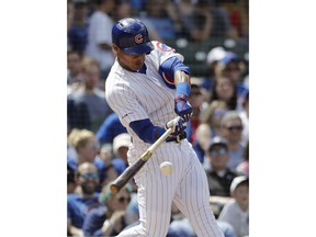 Chicago Cubs' Addison Russell hits a two-run home run during the fourth inning of a baseball game against the Cincinnati Reds, Saturday, May 25, 2019, in Chicago.