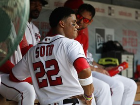 Washington Nationals left fielder Juan Soto (22) talks with teammates in the dugout during their baseball game against the Miami Marlins, Saturday, May 25, 2019, in Washington.