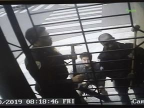 In this May 10, 2019, image from video provided by Bryan Carmody San Francisco police armed with sledgehammers execute a search warrant at journalist Bryan Carmody's home in San Francisco. The San Francisco reporter is seeking the return of property after police raided his home, as officials sought to determine the source of a leaked police report into the death of the city's public defender. An attorney for Carmody will make the request Tuesday, May 21 in San Francisco County Superior Court.