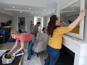 Stagers from Red House Staging and Interiors prepare a home for sale in the District of Columbia.