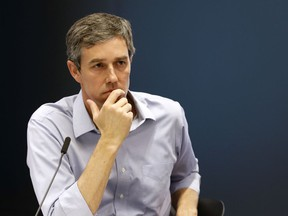 Democratic presidential candidate and former Texas Congressman Beto O'Rourke listens to a speaker during a roundtable discussion on climate change, Monday, May 6, 2019, in Des Moines, Iowa.