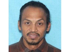 This undated booking photo provided by the Idaho State Police shows Jonathan Llana, 45. A search was underway Thursday, May 23, 2019 in southern Idaho for Llana, suspected of shooting and killing a motorist on a Utah highway, Idaho State Police said in a statement. (Idaho State Police via AP)