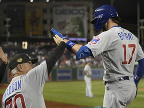 Chicago Cubs' Kris Bryant (17) celebrates his two-run home run with manager Joe Maddon (70) during the ninth inning of a baseball game against the Washington Nationals, Friday, May 17, 2019, in Washington.