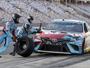 Crew members perform a pit stop on Kyle Busch's car during qualifying for Saturday's NASCAR All-Star auto race at Charlotte Motor Speedway in Concord, N.C., Friday, May 17, 2019.