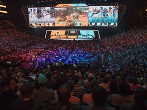 "FILE - In this July 28, 2018, file photo, fans watch the competition between the Philadelphia Fusion and the London Spitfire during the Overwatch League Grand Finals, at Barclays Center in the Brooklyn borough of New York. Overwatch League Commissioner Nate Nanzer is leaving the competitive video game circuit to oversee esports competition for Fortnite publisher Epic Games. Nanzer tweeted Friday night, May 24, 2019, he was moving on from Activision Blizzard, the company behind the Overwatch game and league, for a ""new opportunity."" He didn't provide further details or a firm timeline except to say he'll be leaving ""soon."" Epic Games tells ESPN they will hire Nanzer to help turn the world's most popular video game into a viable esport."