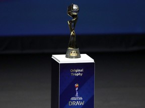 FILE - In this Dec. 8, 2018, file photo, the Women's World Cup trophy is displayed at the women's soccer 2019 World Cup draw, in Boulogne-Billancourt, outside Paris. Fans planning to attend the Women's World Cup in France are finding out that the seats they bought might not be together. Tickets were made available to print Monday, May 20, 2019, and ticket holders learned that their groups were sometimes split up in separate rows and even sections, even families with young children.