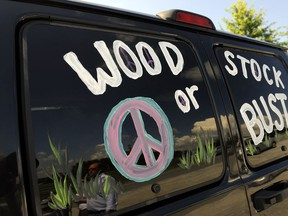 """FILE - This Aug. 14, 2009 file photo shows a van decorated with """"Woodstock or Bust"""" at the original Woodstock Festival site in Bethel, N.Y. On Thursday, May 9, 2019, a judge in New York has ordered London-based Dentsu Aegis Networks not to make any further comments on the future of the 50th Anniversary Festival at least until a hearing on Monday, May 13, 2019, after the festival's organizers sued the former investor. Festival organizers brought suit claiming that the former investor was verbally and financially sabotaging the August 2019 event."""