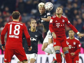 File---Picture taken Dec.19, 2018 shows Leipzig's Kevin Kampl, left, and Bayern's Thiago challenging for there ball during the German Bundesliga soccer match between FC Bayern Munich and RB Leipzig in Munich, Germany.