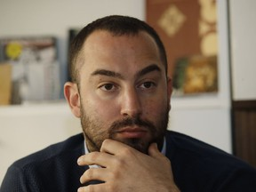 Francesco Polacchi, regional coordinator of Casapound extreme right political party, and founder of Altaforte publishing company, answers to reporters during a news conference, in Milan, Italy, Wednesday, May 8, 2019. Holocaust survivor, poet Halina Birenbaum, is set to open a book fair in Turin after the organizers agreed to demands that she and the Auschwitz-Birkenau state museum made to remove the stand of Altaforte publishing company.