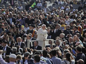 Pope Francis is driven through the crowd as he arrives for his weekly general audience, in St. Peter's Square, at the Vatican, Wednesday, May 8, 2019.
