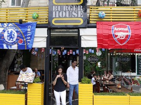 A restaurant is decorated with Chelsea and Arsenal flags, in central Baku, Azerbaijan Tuesday, May 28, 2019. Supporters were arriving in the Azerbaijan capital ahead of Wednesday's Europa League final between English teams Arsenal and Chelsea.