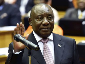 In this photo supplied by the South African Government Communications and Information Services (GCIS) Cyril Ramaphosa is sworn in as a member of parliament in Cape Town, South Africa, Wednesday, May 22, 2019. Ramaphosa has taken steps to crack down on corruption Wednesday as the country's new parliament voted him to lead the country for a five-year term.