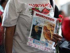 A woman holds a sign during the closing ceremony of the National Inquiry into Missing and Murdered Indigenous Women and Girls in Gatineau, Quebec, on June 3, 2019.
