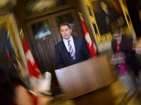 Conservative Leader Andrew Scheer talks to the media in the foyer of the House of Commons on Parliament Hill, in Ottawa on Monday, June 10, 2019.