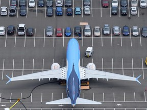 A Boeing 737 MAX airplane is stored on an employee parking lot adjacent to Boeing Field, on June 27, 2019 in Seattle, Washington.