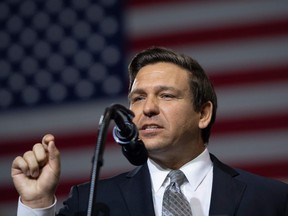 In this file photo taken on July 31, 2018 U.S. Representative Ron DeSantis, Republican of Florida, and candidate for Florida Governor, speaks during a rally with U.S. President Donald Trump at Florida State Fairgrounds Expo Hall in Tampa, Florida.