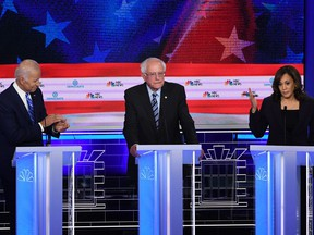 In this file photo taken on June 27, 2019, U.S. Senator for California Kamala Harris (R) speaks alongside former U.S. Vice President Joseph R. Biden Jr. (L) and U.S. Senator for Vermont Bernie Sanders during the second Democratic primary debate of the 2020 presidential campaign season hosted by NBC News at the Adrienne Arsht Center for the Performing Arts in Miami, Florida.