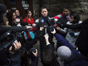 John Lee, lawyer for Qing Quentin Huang, speaks outside of the courthouse after Huang's bail hearing was put off until a later date in Toronto, Wednesday, December 4, 2013.