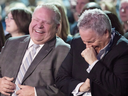 Ontario Premier Doug Ford and Chief of Staff Dean French share a joke at the Ontario PC Convention in Toronto on Nov. 17, 2018.